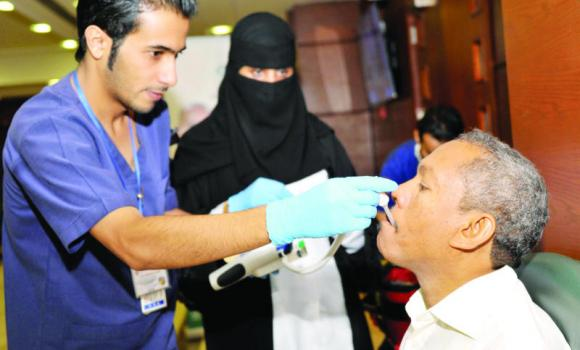 A volunteer is given the influenza vaccine at the launch of the campaign.