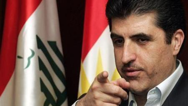 Iraqi Kurdistan Prime Minister Nechirvan Barzani gestures towards reporters during a news conference in Arbil, 310 km (190 miles) north of Baghdad March 24, 2009.