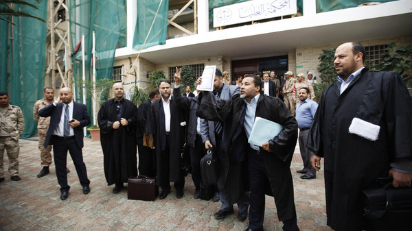 Libyan lawyers celebrate after the court invalidated the country's parliament, outside the Supreme Court in Tripoli, Nov. 6, 2014.