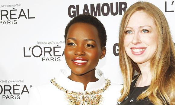 Lupita Nyong'o and Chelsea Clinton arrive for the 2014 Glamour Women of the Year Awards in New York.