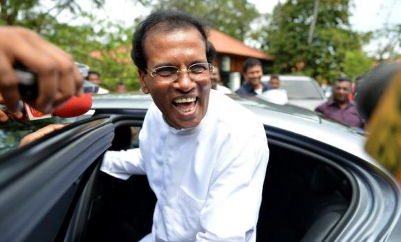 Maithripala Sirisena smiles as he speaks with supporters in Colombo.