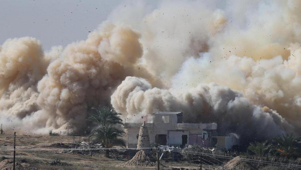 Smoke rises as a house is blown up during a military operation by Egyptian security forces in the Egyptian city of Rafah, near the border with southern Gaza Strip.