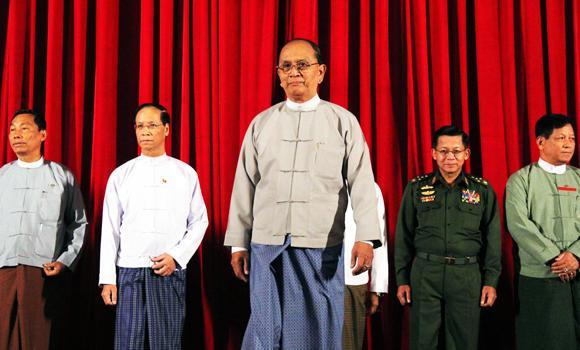 Myanmar's President Thein Sein leaves after posing for pictures following a meeting at the presidential palace at Naypyitaw, in this Oct. 31, 2014 photo.