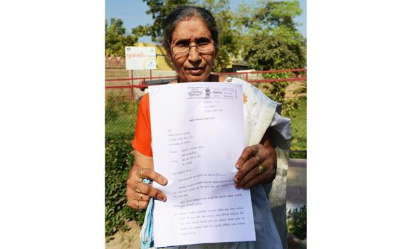 Narendra Modi's wife, Jashodaben holds a copy of the Right To Information (RTI) application filed by her in Ahmedabad on Monday.