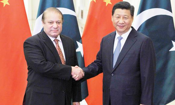 Pakistan's Prime Minister Nawaz Sharif shakes hands with China's President Xi Jinping before a meeting in Beijing.