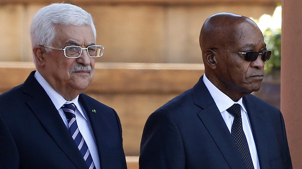 Palestinian President Mahmoud Abbas (L) stands with South Africa's President Jacob Zuma at the Union Building in Pretoria November 26, 2014. Abbas is on a state visit to South Africa.