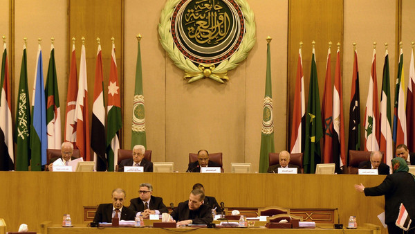 Palestinian president Mahmud Abbas (C-L) seen attending an extraordinary Arab League meeting to discuss the situation in the Palestinian territories, in Cairo on November 29, 2014.