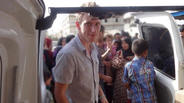 Peter Kassig in front of a truck somewhere along the Syrian border between late 2012 and autumn 2013 as Special Emergency Response and Assistance (SERA) was delivering supplies to refugees.