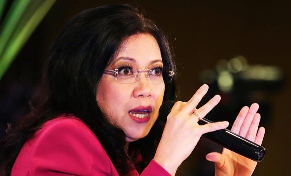 In this Aug. 28, 2014 photo, Philippine Chief Justice Maria Lourdes Sereno answers questions from reporters in Manila, Philippines.