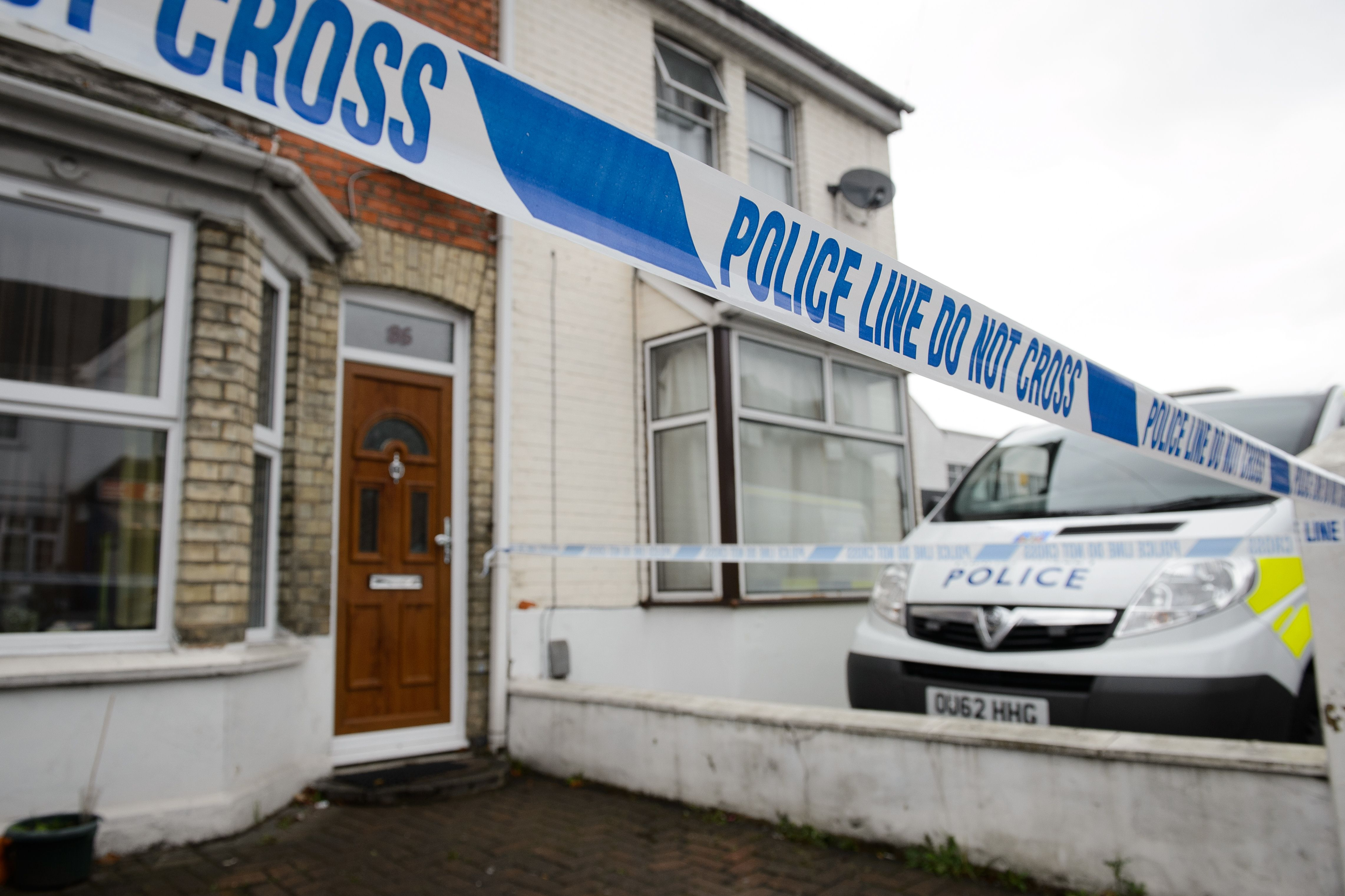 Police tape marks off the front of a residential address north west of London, on November 8, 2014.
