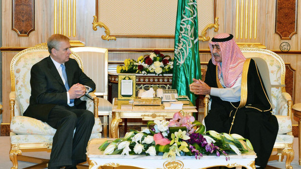 Saudi Arabia's Deputy Prime Minister Prince Muqrin bin Abdulaziz al-Saud (R) meeting with the Duke of York, Prince Andrew.