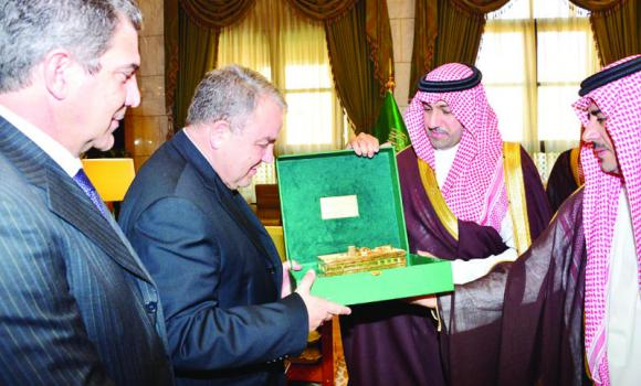 Riyadh Gov. Prince Turki bin Abdullah bin Abdul Aziz and Maltese Parliament Speaker Angelo Ferrugia exchange commemorative gifts following a meeting in the Saudi capital on Tuesday. (SPA)