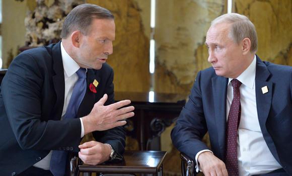 Russian President Vladimir Putin (R) listens to Australia's Prime Minister Tony Abbott.