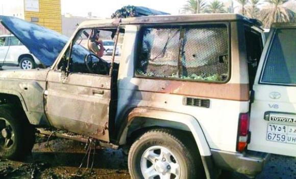 The burned out vehicle of the policemen shot and wounded in an attack by an unknown assailant in Qatif on Tuesday.