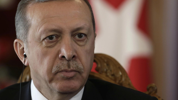 Turkey's President Recep Tayyip Erdogan listens during a news conference in Riga October 23, 2014.
