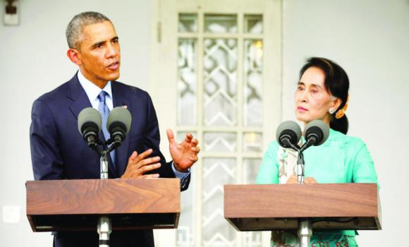 US President Barack Obama and opposition politician Aung San Suu Kyi hold a press conference after their meeting at her residence in Yangon on Friday.