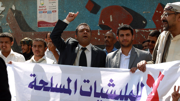 Yemeni activists shout slogans during a rally in Sanaa, on November 1, 2014, against the control by Houthi fighters on the country's main cities.