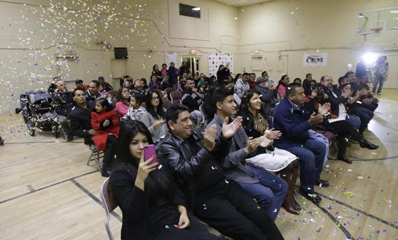 People cheer following President Barack Obama's nationally televised address at Centro Civico Mexicano on Thursday in Salt Lake City.