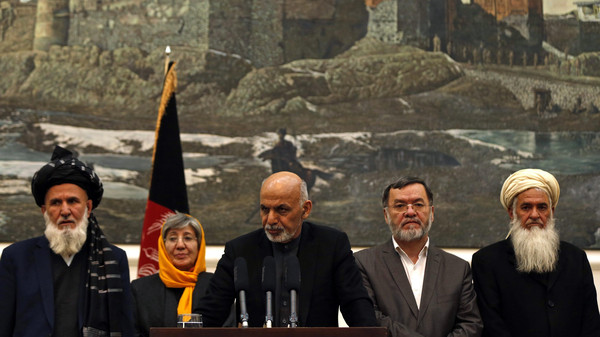 Afghanistan's President Ashraf Ghani (C) speaks to the media during an event in Kabul December 10, 2014.
