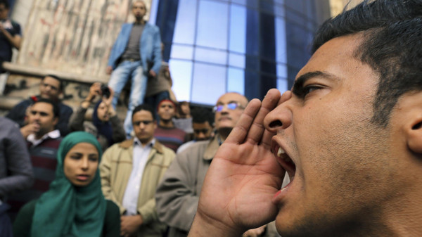 A man shouts anti-government slogans during a protest against the court dropping its case against Egypt's former President Hosni Mubarak, in Cairo December 2, 2014.