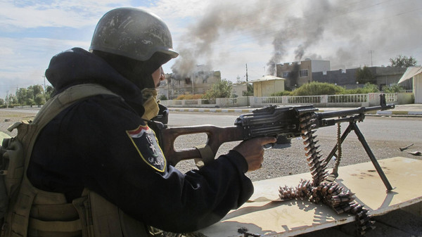 A member of the Iraqi security forces mans a gun during an intensive security deployment after taking control of Saadiya in Diyala province from ISIS militants, November 24, 2014.