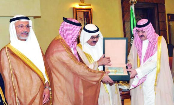 Jeddah Gov. Prince Mishaal bin Majed receives a copy of the studies on cover-up businesses by expats at his office.