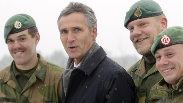 NATO Secretary General Jens Stoltenberg poses with Norwegian army soldiers deployed in Latvia at Adazi military base November 21, 2014.