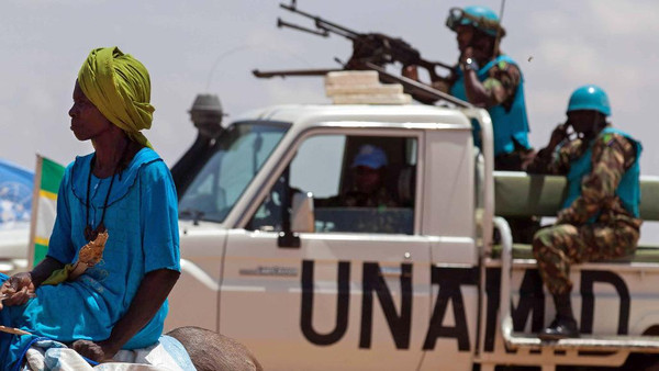 """The expulsions follow Bashir's call for a """"clear program"""" to end the joint mission in Darfur, known as UNAMID, established in 2007 to protect civilians caught in a 2003 conflict between rebels and the government"""