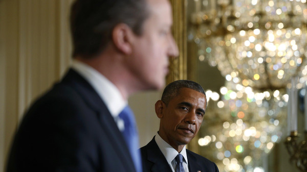U.S. President Barack Obama (R) listens to British Prime Minister David Cameron during a joint news conference following their meeting at the White House in Washington January 16, 2015.