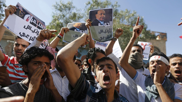 Protesters shout slogans during an anti-Houthi demonstration in Sanaa.
