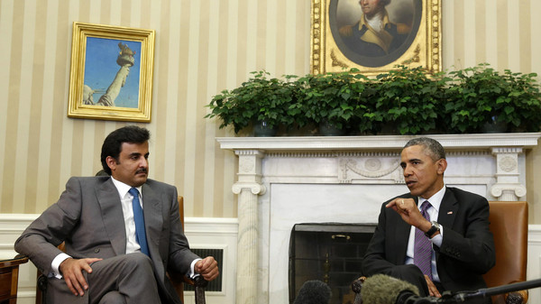U.S. President Barack Obama meets with Emir of Qatar Sheikh Tamim bin Hamad al Thani while in the Oval Office at the White House in Washington February 24, 2015.