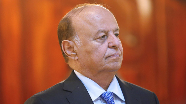 Yemen's President Abdu Rabbu Mansour Hadi stands during a reception ceremony during the holy fasting month of Ramadan at the Republican Palace in Sanaa in 2014.