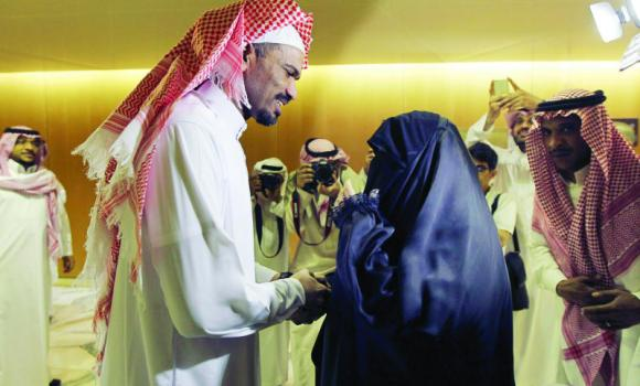 Abdullah Al-Khalidi shakes hands with his aunt upon his arrival at King Khaled International Airport in Riyadh on March 2.
