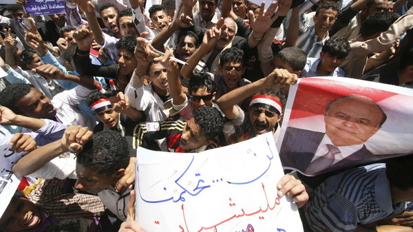 Anti-Houthi protesters shout slogans during a demonstration to show support to Yemen's President Abd-Rabbu Mansour Hadi in the southwestern city of Taiz March.