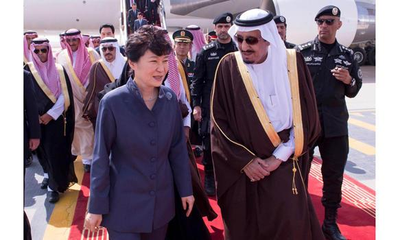 Custodian of the Two Holy Mosques King Salman receives South Korean President Park Geun-hye on her arrival in Riyadh on Tuesday. (SPA)