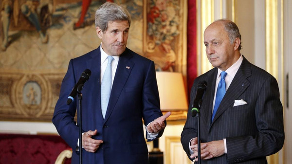 French Foreign Minister Laurent Fabius (R) and U.S. Secretary of State John Kerry speak during joint statement at the Quai d'Orsay Foreign Affairs ministry in Paris on Nov. 20, 2014.