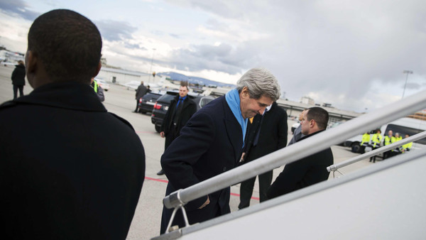 U.S. Secretary of State John Kerry boards his plane after delivering remarks in Montreux.