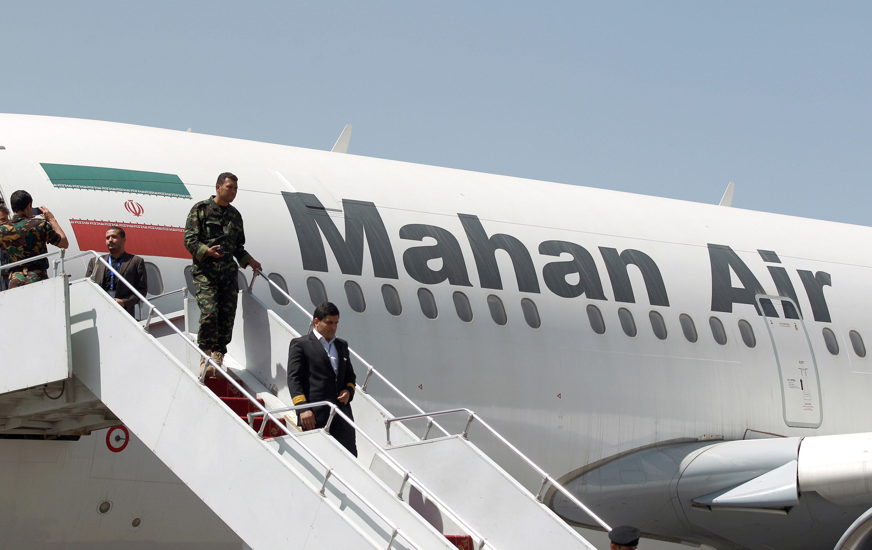 """An airplane of Mahan Air sits at the tarmac after landing at Sanaa International Airport in the Yemeni capital on March 1, 2015 a day after officials from the Shiite militia-controlled city signed an aviation agreement with Tehran. Western-backed President Abedrabbo Mansour Hadi, who fled last weekend an effective house arrest by the Huthis in Sanaa, slammed the agreement as """"illegal,"""" according to an aide."""