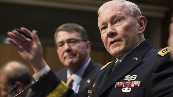 U.S. Defense Secretary Ash Carter (L) listens as Chairman of the Joint Chiefs of Staff Army General Martin Dempsey testifies before a Senate Armed Services Committee in Washington March 3, 2015.