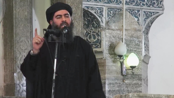 The leader of ISIS, Abu Bakr al-Baghdadi, preaches in a sermon last year.