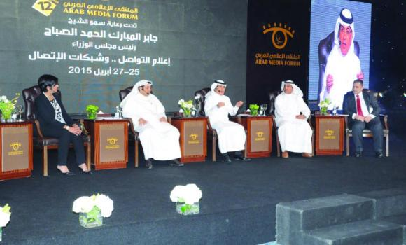 Arab News Editor in Chief Mohammed Fahad Al-Harthi, center, speaks during the main session of Arab Media Forum in Kuwait.