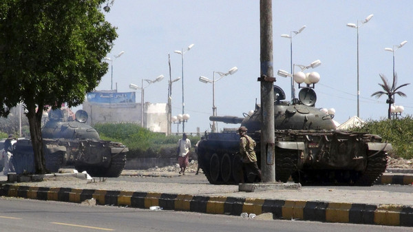Army tanks are deployed during clashes in Aden.