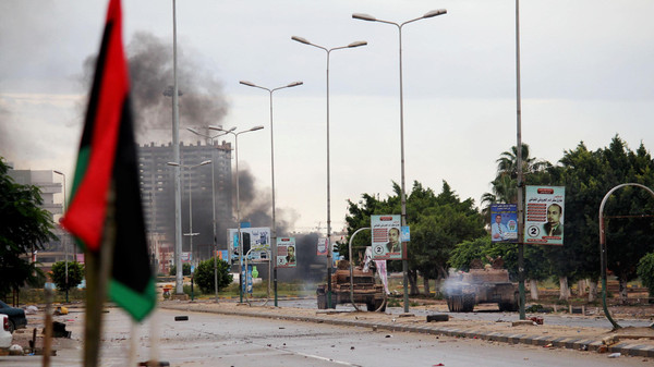In this 2014 file photo, smoke rises during clashes between the Libyan military and Islamic militias in Benghazi, Libya.