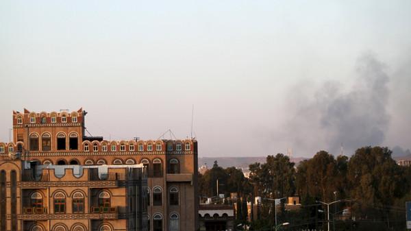 Smoke billows near military barracks in the Jabal al-Jumaima mountain following an air strike near Sanaa March 30, 2015.