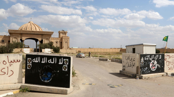 Signs belonging to the ISIS group remain at the entrance of one of Saddam Hussein's palaces in Tikrit, April 2, 2015.
