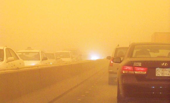 Poor visibility in Riyadh forces motorists to switch on headlights of their vehicles.