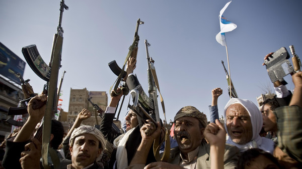Shiite rebels, known as Houthis, hold up their weapons to protest against Saudi-led airstrikes, during a rally in Sanaa, Yemen, April 1, 2015.