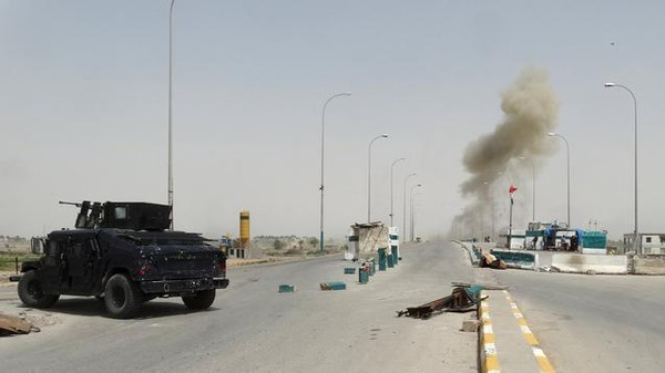 Smoke rises from a bomb attack in clashes between Iraqi security forces and ISIS militants on the outskirts of Ramadi.