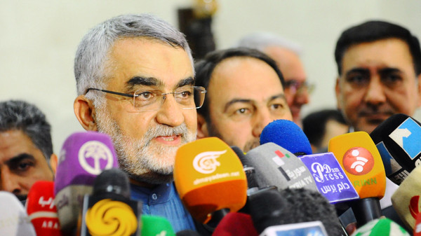 Chairman of the Foreign Policy and National Security Committee at the Iranian Shura Council, Alaeddin Boroujerdi (C), speaking to the press following a meeting with Syrian officials in the capital Damascus.