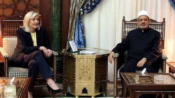Egyptian grand Imam of al-Azhar Sheikh Ahmed el-Tayeb (R) meets with the leader of the French far-right Front National party Marine Le Pen (L), in al-Azhar headquarters in Cairo on May 28, 2015.